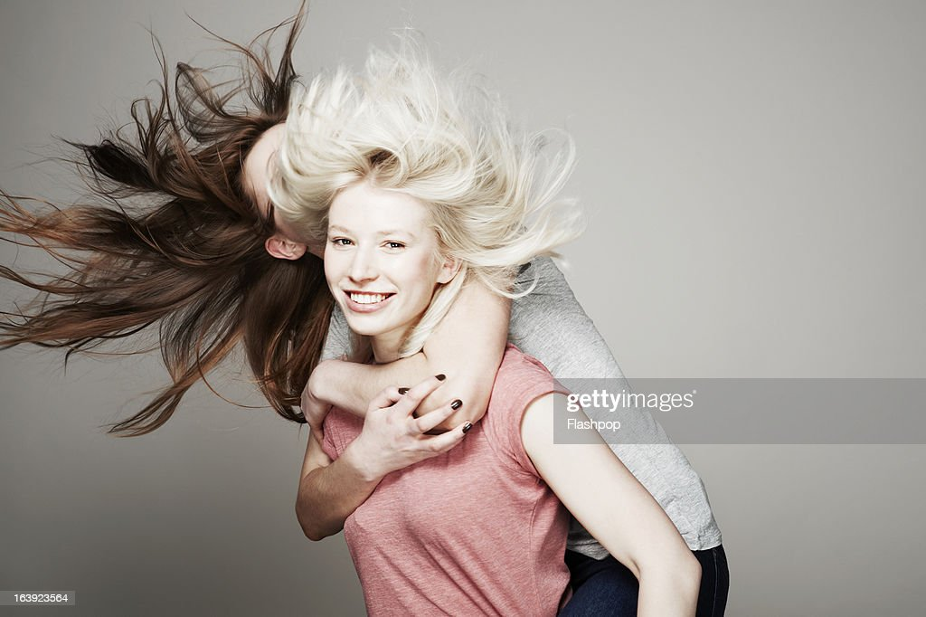 Studio portrait of two women who are best friends : Stock Photo