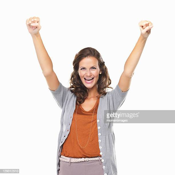 Studio portrait of woman enjoying success with hands raised