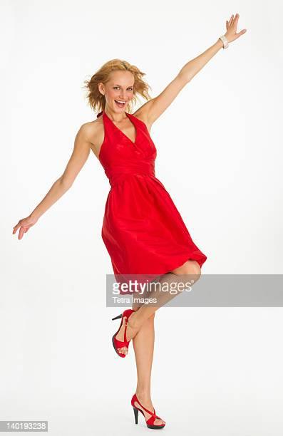 studio portrait of woman in red dress