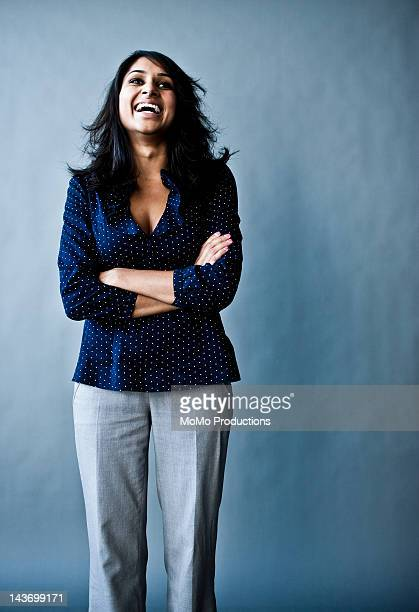 studio portrait of woman laughing