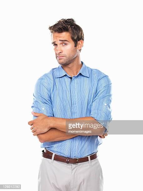 Studio portrait of young business man looking askance