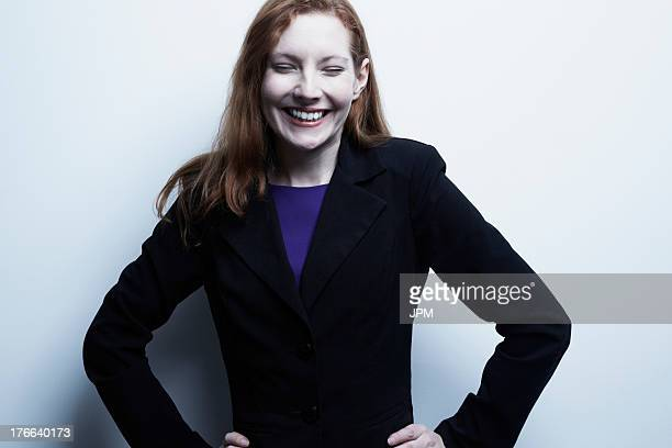 Studio portrait of young businesswoman smiling
