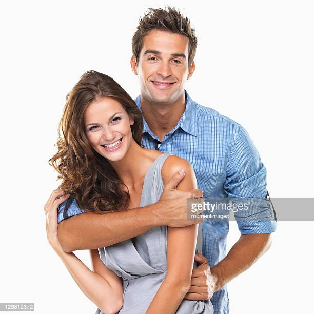 Studio portrait of young couple smiling