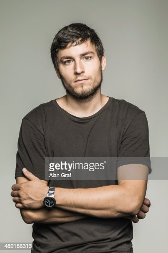 Studio portrait of young man in black tshirt