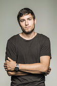 Studio portrait of young man in black tshirt