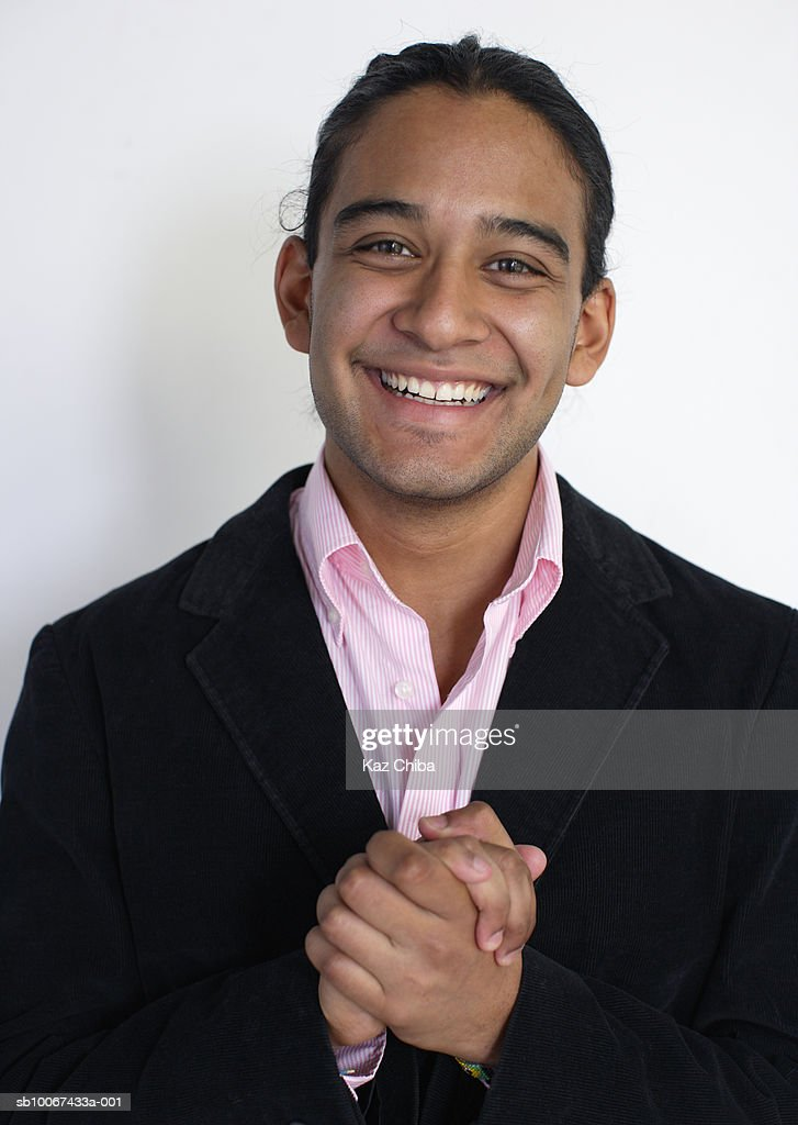 Studio portrait of young man smiling : Stock Photo