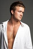 Studio Portrait Of Young Man Wearing Open Shirt