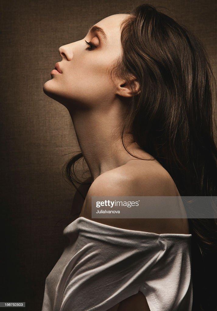 Studio portrait of young sensual woman in profile : Stock Photo