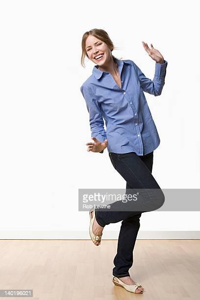 Studio portrait of young woman dancing