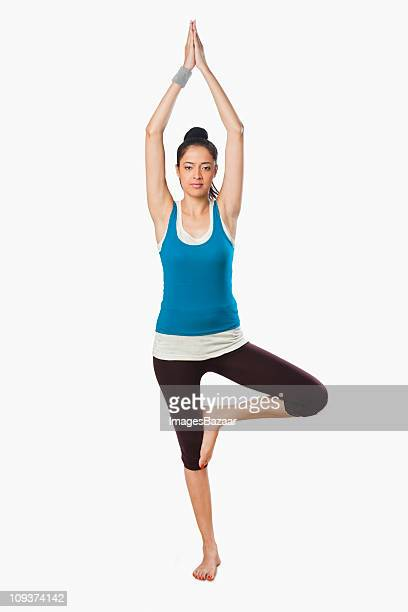 Studio portrait of young woman practicing yoga