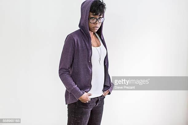 Studio portrait of young woman wearing hoody