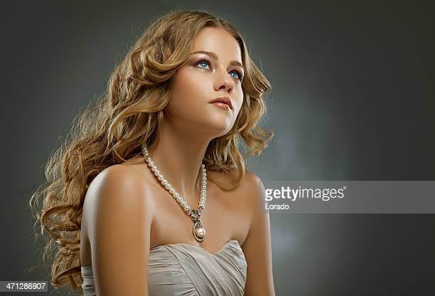 studio shoot of woman with beautiful curled blond hair