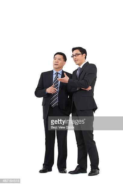 studio shot business men talking