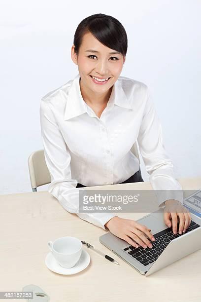 studio shot business woman working