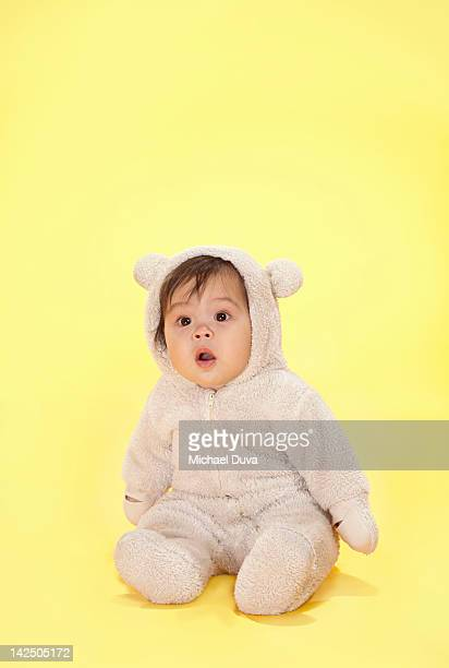 Studio shot of a baby dressed as a bear