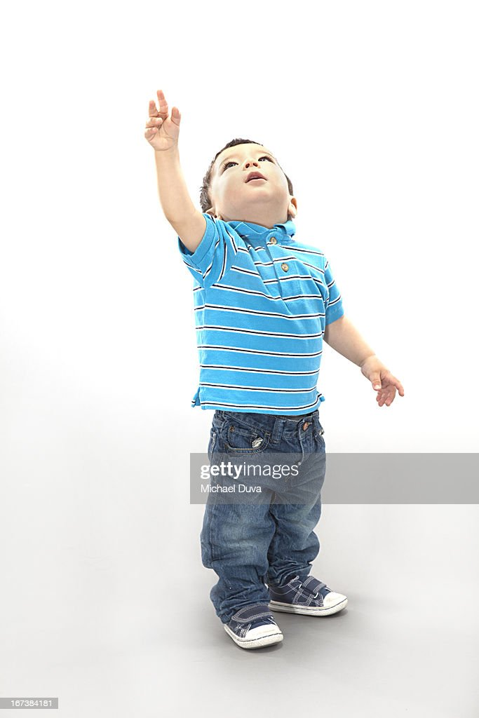 studio shot of a child excited on gray background : Stock Photo