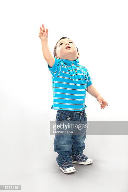 studio shot of a child excited on gray background