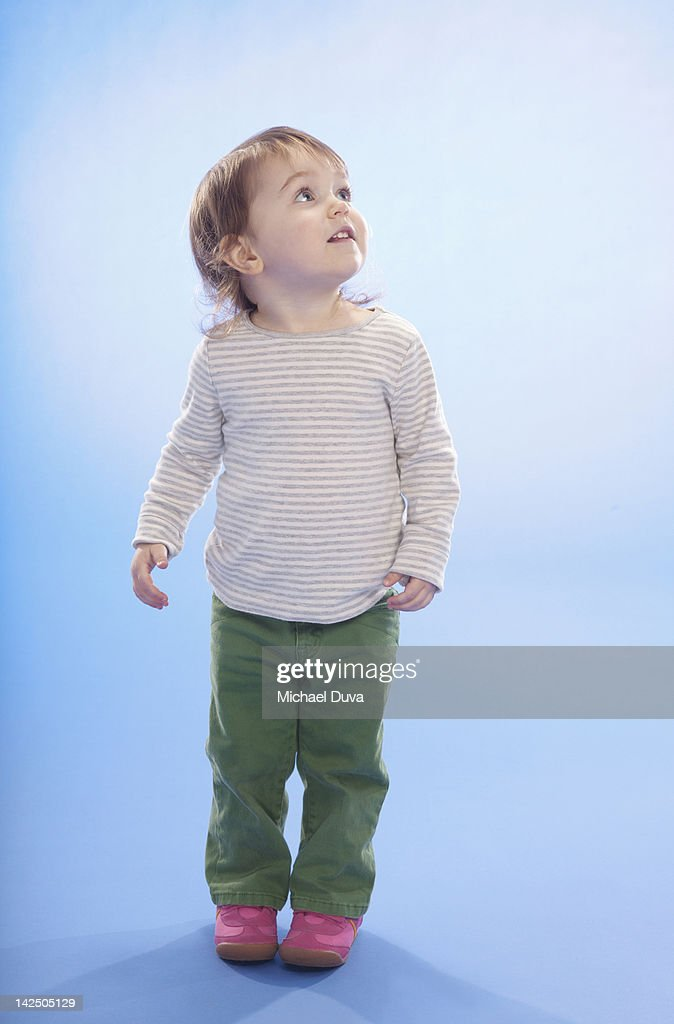 Studio shot of a child interested off frame : Stock Photo
