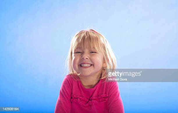 studio shot of a child with a huge smile