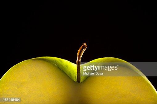 studio shot of a green apple slice on black : Stock Photo