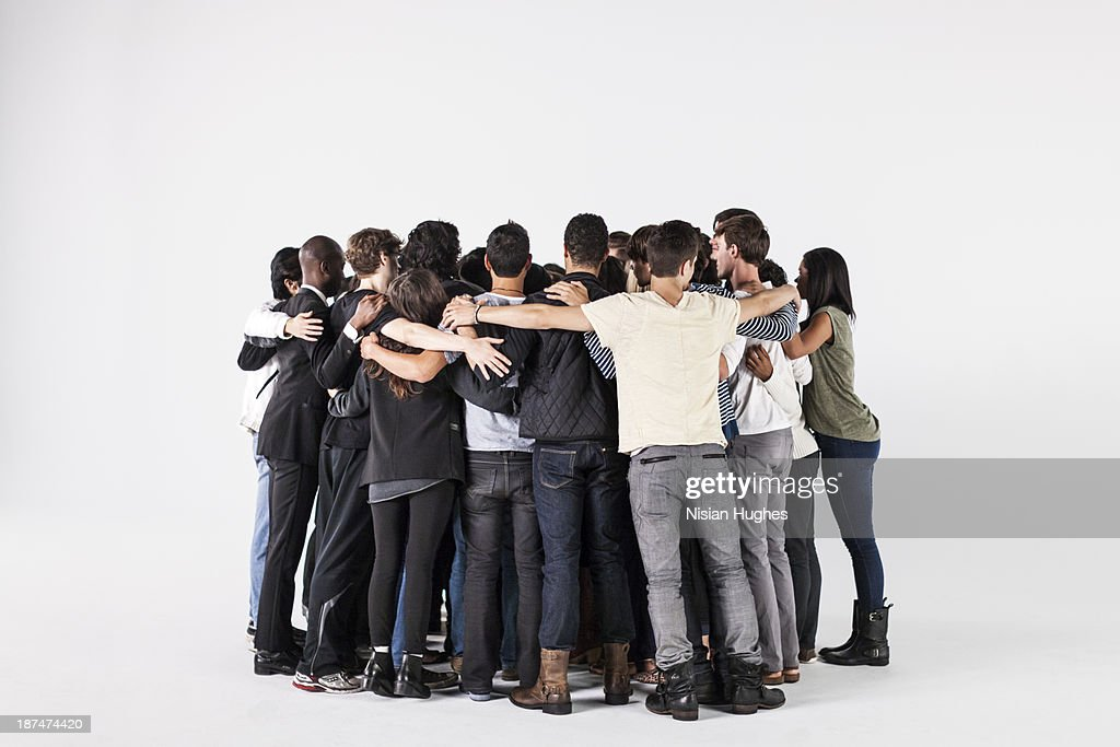 Studio Shot of a Group of People in a Huddle