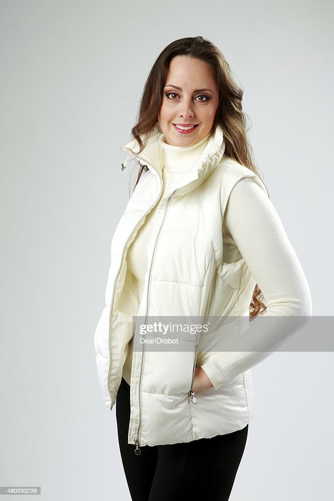 Studio shot of a happy woman standing : Stock Photo