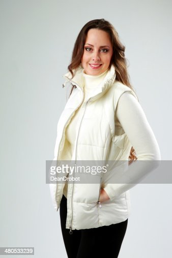 Studio shot of a happy woman standing : Stockfoto
