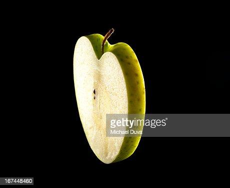 studio shot of a heart shaped  green apple : Stock Photo