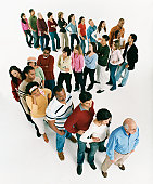Studio Shot of a Large Mixed Age, Multiethnic Group of Bored Men and Women Waiting in Line