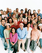 Studio Shot of a Large Mixed Age, Multiethnic Group of Smiling Men and Women