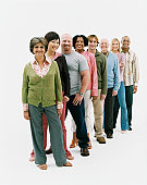 Studio Shot of a Mixed Age, Multiethnic Group of Men and Women Standing in a Line