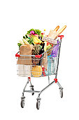 A studio shot of a shopping cart full with healthy groceries isolated on white background