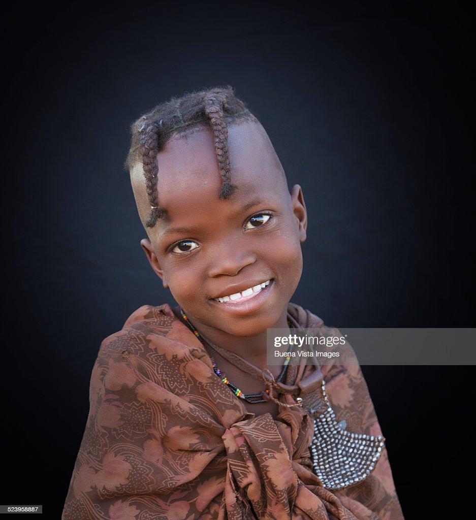 Studio shot of a smiling Himba girl