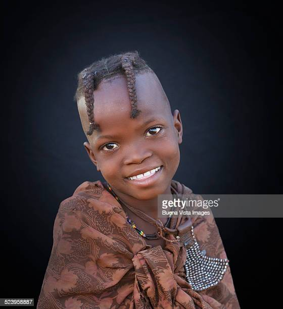 Studio shot of a smiling Himba girl