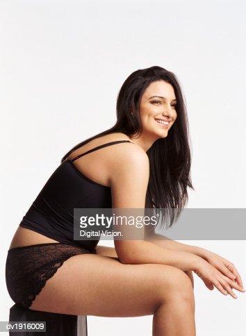 Studio Shot of a Voluptuous Woman in Her Underwear