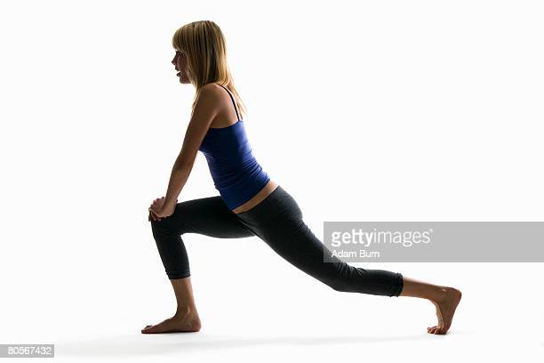 Studio shot of a woman in a lunge pose