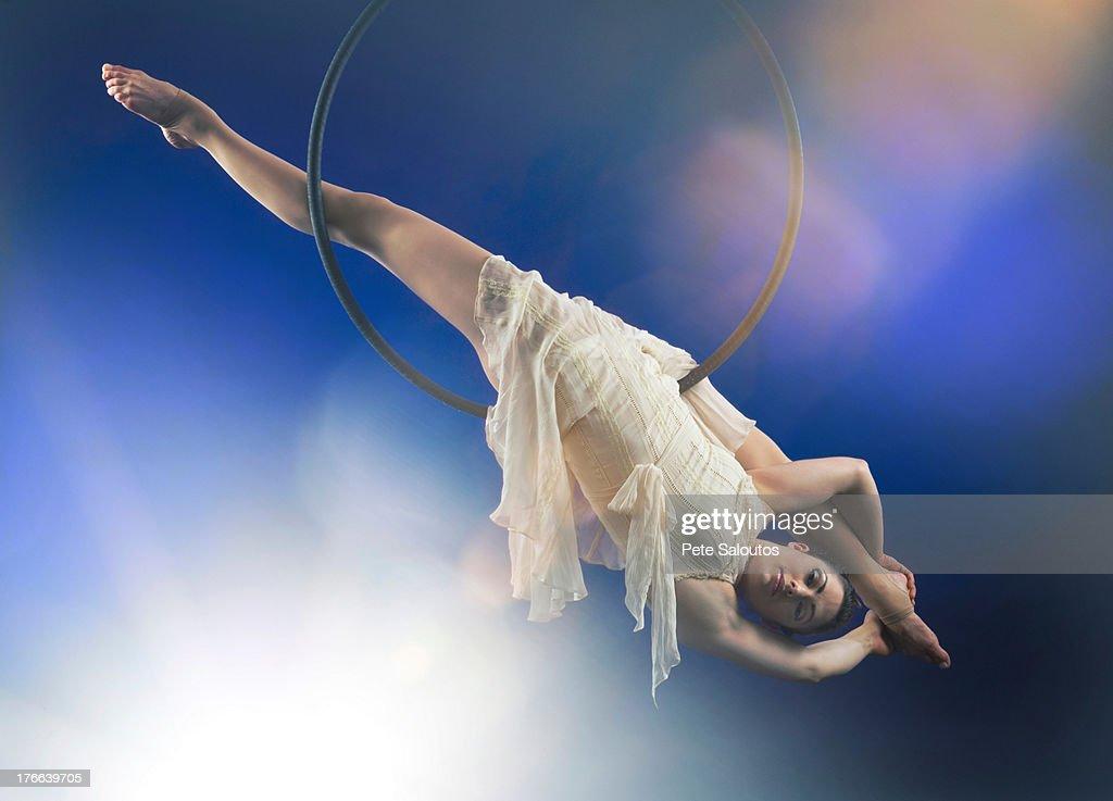 Studio shot of aerialist performing on hoop