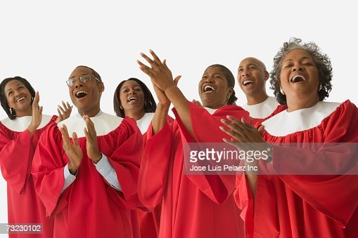 Studio shot of African men and women in choir gowns singing