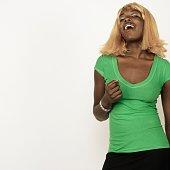 Studio shot of African woman wearing blonde wig