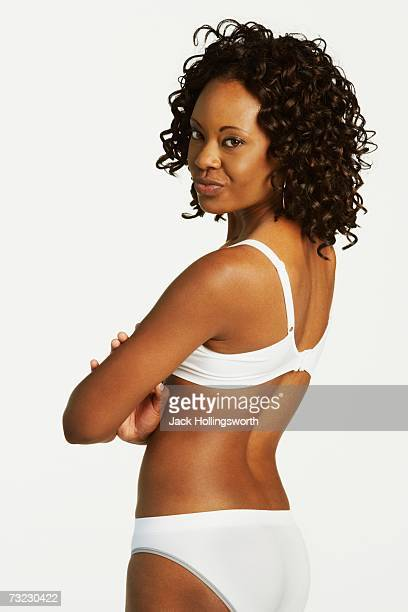 Studio shot of African woman wearing underwear and looking over shoulder