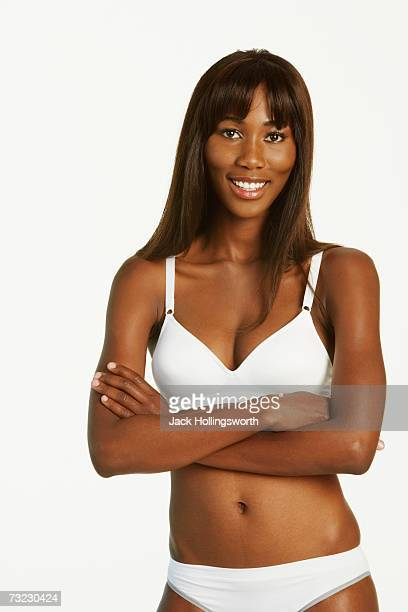 Studio shot of African woman wearing underwear with arms crossed