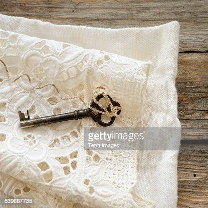 Studio shot of antique key on lace cloth