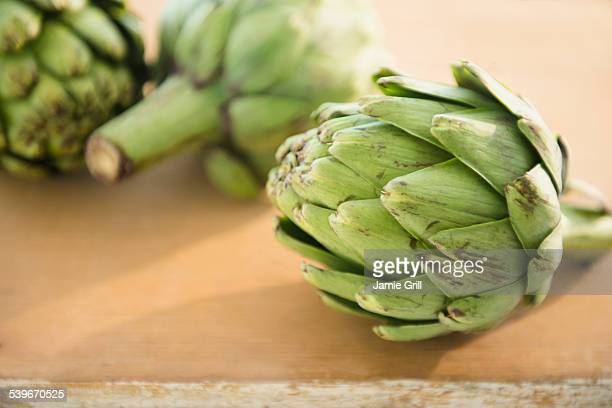 Studio shot of artichokes on table