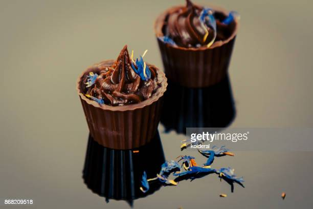 Studio shot of artisan handmade chocolate decorated with blue flowers
