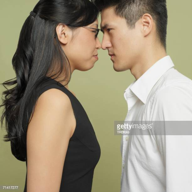Studio shot of Asian couple head to head