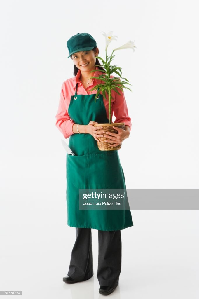Studio shot of Asian female gardener