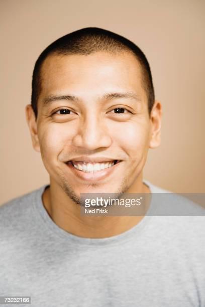 Studio shot of Asian man smiling