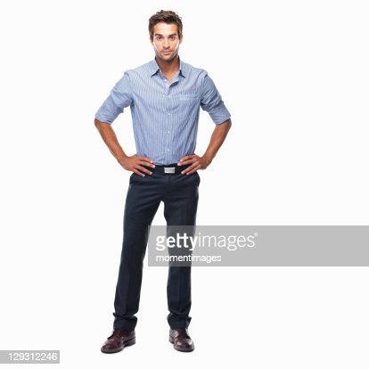 Studio shot of attractive business man standing with hands on hips