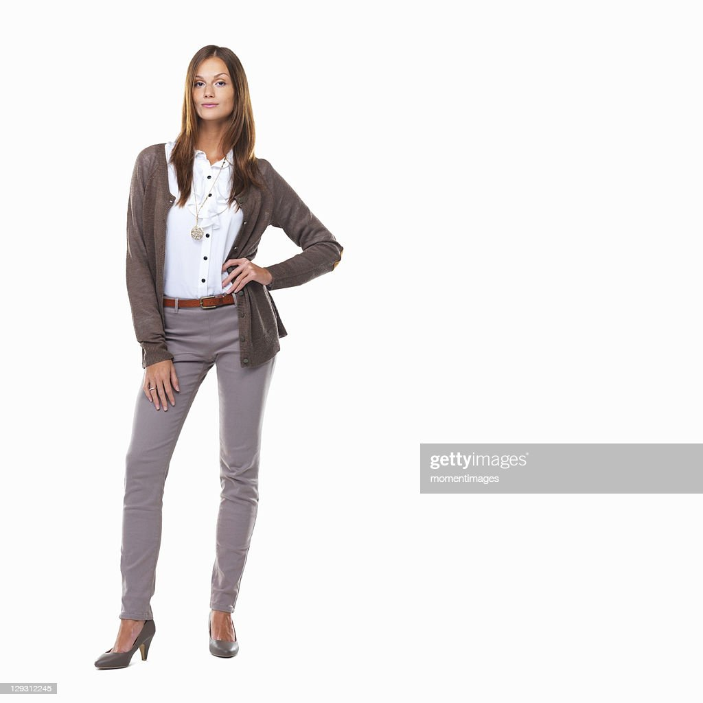 Studio shot of attractive sarcastic business woman standing with hand on hip