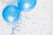 Studio shot of balloons on colored spotted background